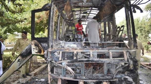 A scene of the charred bus which was completely destroyed in bomb blasts in Quetta