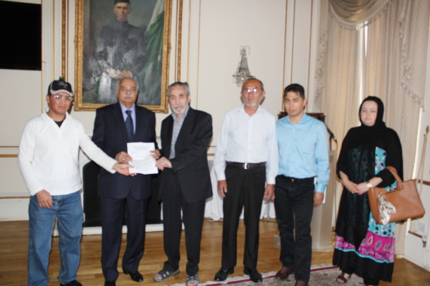 Pakistani High Commissioner being presented with the Petition.