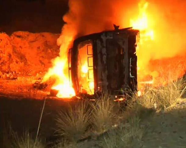 The targeted passenger bus in flames.