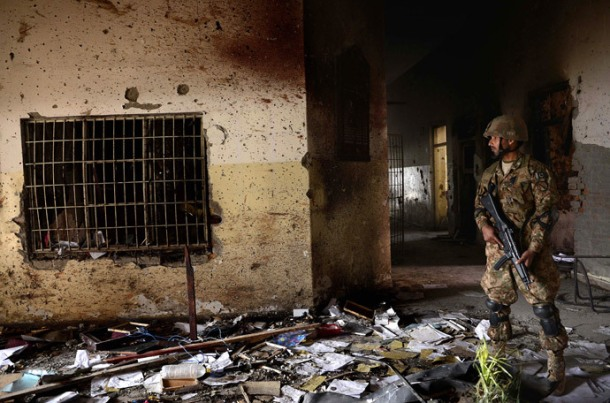 In this photograph taken on December 18, 2014, a Pakistani army soldier stands guard at the site of a militant attack on an army-run school in Peshawar.