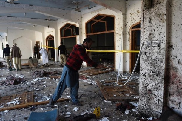 Pakistani security personnel inspect the mosque following the attack. A Majeed/AFP / Getty Images